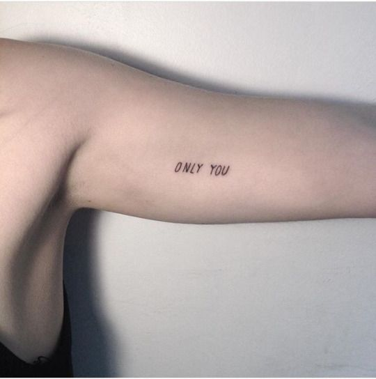 arm word tattoo